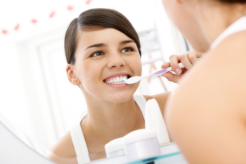 Annerley-dentist-Complete-dental-works-regularly-Brushing-Teeth